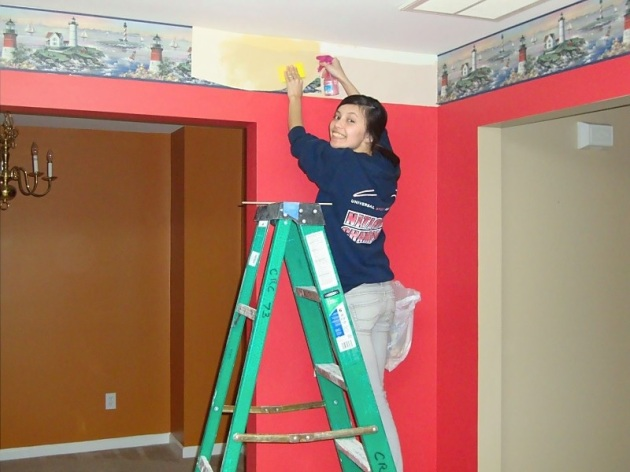 Old picture of me taking down the kitchen wallpaper border before we actually moved in.