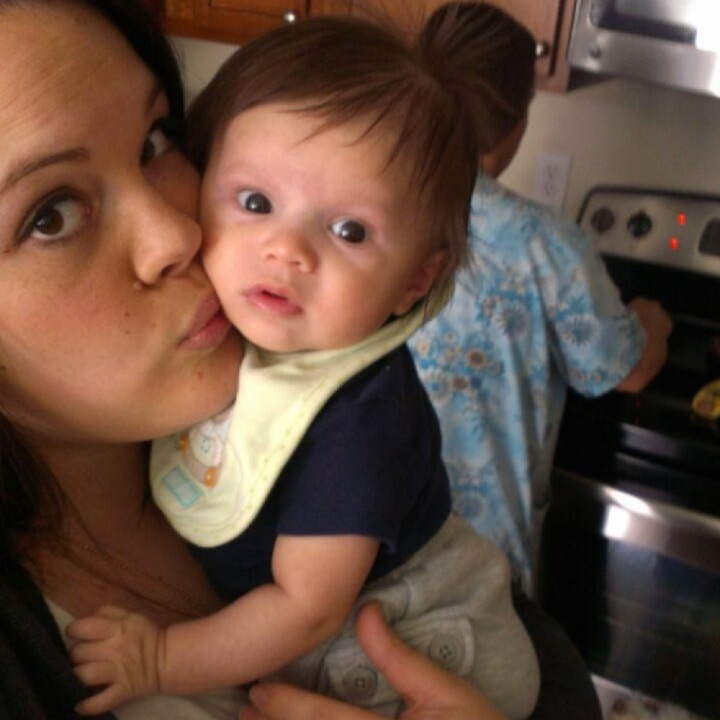 My SIL stealing kisses. =]